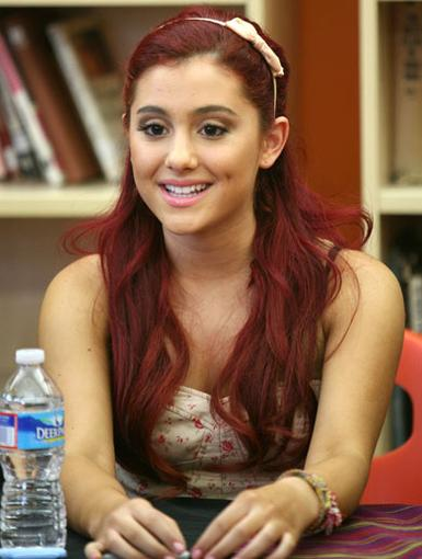 Fashion On Fire|Ariana always knows how shine. Her fiery red hair and adorable headband compliment her sweet smile!