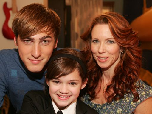 Fam Cam|Kendall poses with his mom and smarty-pants sister for a cute family pic!