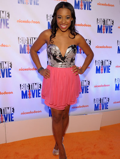 Happy Helper|Tanya Chisholm rocked her role as the Rocque Records assistant in Big Time Rush, and she showed up glowing on the Orange Carpet to celebrate.