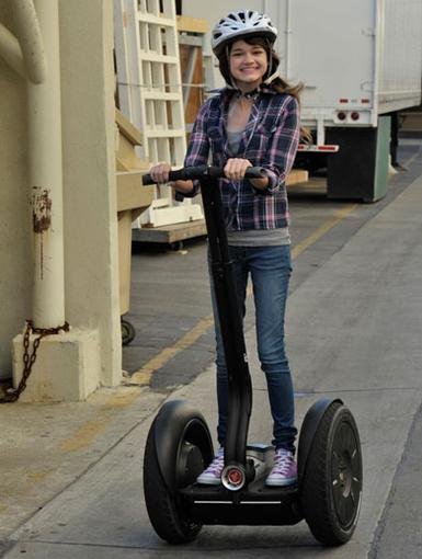 Ridin' Green|There's no hitchin' a ride on this badboy. Ciara Bravo is ridin' fast and solo, segway-style.