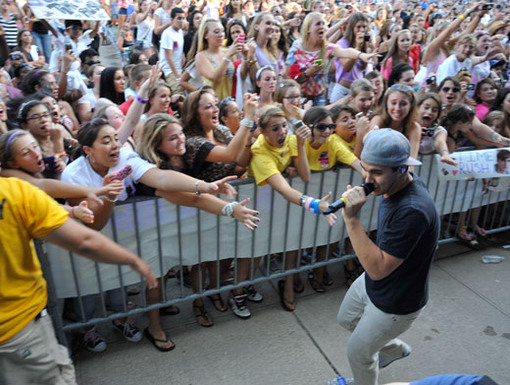 Security Breach!|When Carlos stepped off stage to greet the audience, all the fans went wild!
