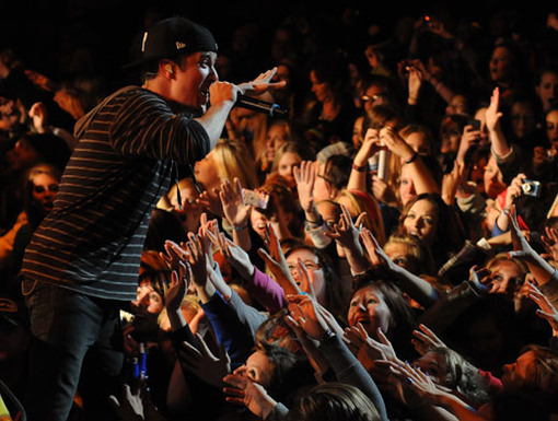 Close, But Not Close Enough!|Fans try to reach out for Logan's hand as he sings. You guys were so close!