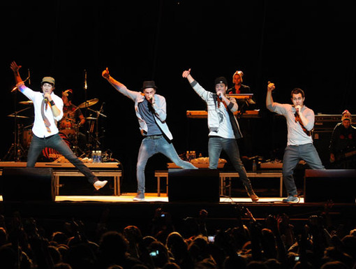 Jump Around|The guys jump into their awesome dance moves while singing on stage.