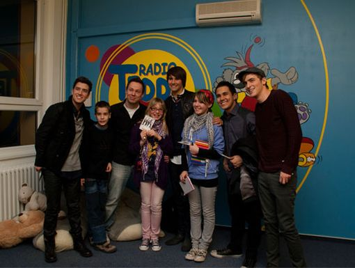 BTR.FM|Big Time Rush pose for a pic with fans after their acoustic performance at Germany's Radio Teddy.