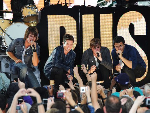 Big Time Rush get down on bended knee and take their message directly to the crowd.