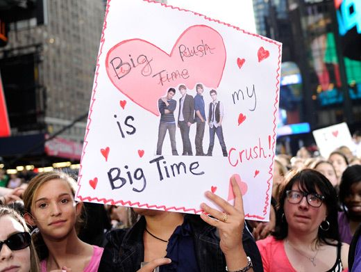 This mysterious Big Time fan covers her face with a homemade poster that could win the heart of any kind of guy.