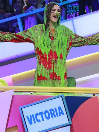 Complimentary Colors|Victoria Justice proudly shows off her newest wardrobe accessory -- a lot of green slime!
