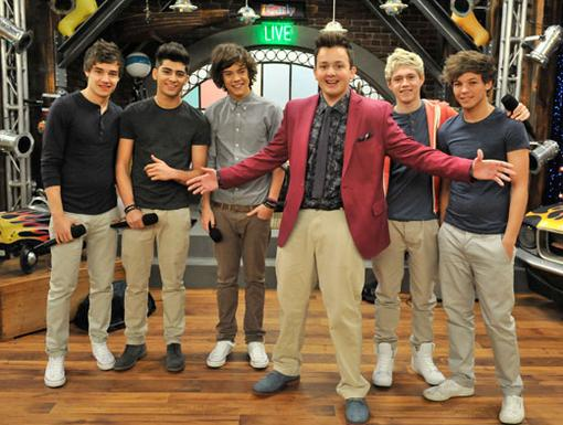 6D|Is Gibby the newest addition to One Direction?! That gray shirt and khakis has us wondering...