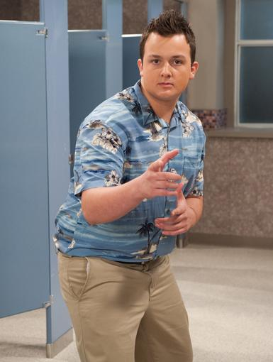 Hey You! Noah makes a gesture that seems to say, 'Don't forget to catch this awesome new episode!'