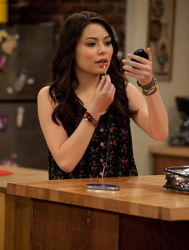Pucker Up|Carly puts on some gloss, perhaps she's prepping for a date??