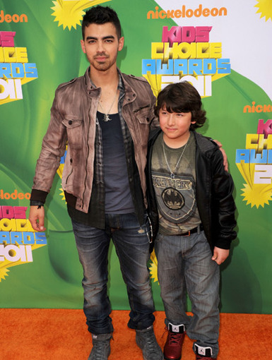 Bonus Jonas|Joe Jonas hung out with Frankie Jonas, aka the Bonus Jonas on the Orange Carpet.