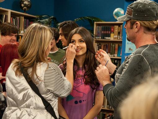 You're Making Me Blush! Victoria pauses for a quick make-up touch up in between scenes. Doesn't she look purdy?
