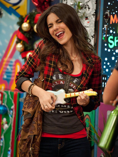 Miniature Music|Even though this guitar is just a tiny toy, Victoria can still use it to rock around the Christmas tree!