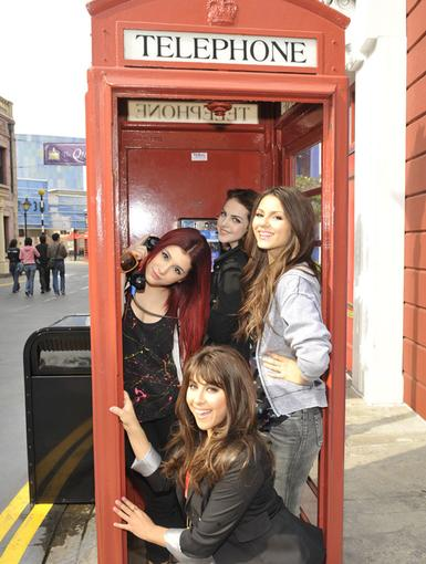 Telephone Break|What's better than working with your BFFs every day? Posing for pics with them! The Victorious girls smile it up in this old school phone booth in between takes.