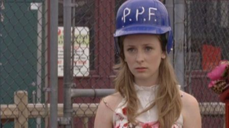 SPOILER ALERT! Holly J has an alien brain implanted in her head and must wear a protective helmet to keep from telepathically reversing the space-time continuum in the Degrassi NY movie.