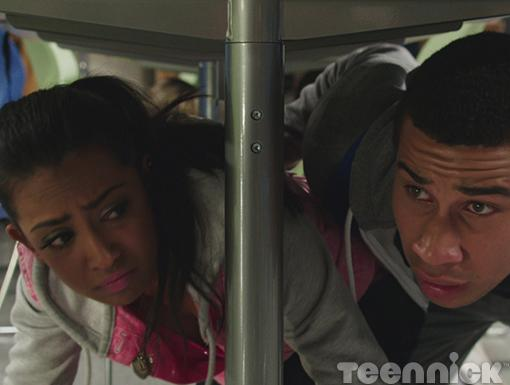 Dallas and Alli hide under a table after an explosion at the mall.