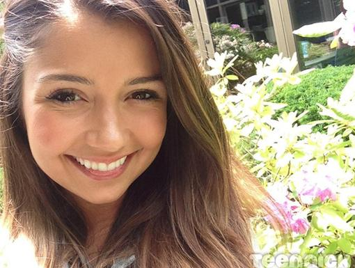 Cristine Prosperi enjoys the beautiful summer weather during a break from filming.