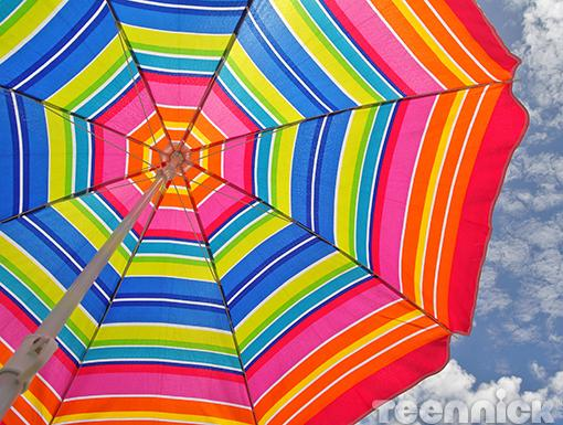 Colorful Umbrella|The beach can get crowded, and after a swim in the ocean, you might forget where you left all your stuff. A distinct umbrella or flag will help you find your way back!