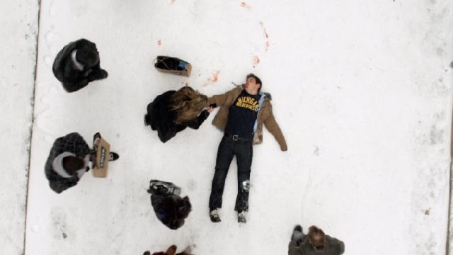 Drew lies in the snow post-attack on Degrassi